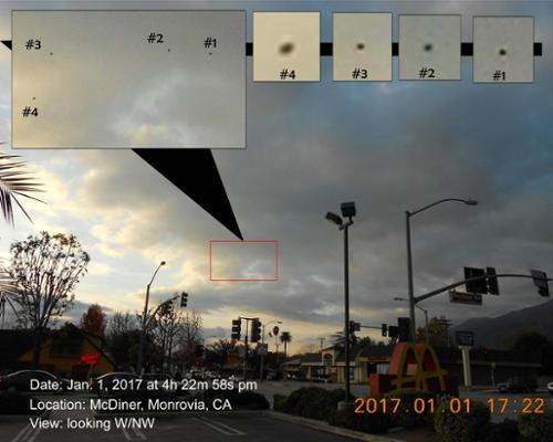 "Also known as Image #1677, this is the first photo from the ""McDiner UFO Event"" of January 1, 2017. The four craft had already dropped out of the clouds & were flying generally northward towards the mountains against purpendiculary gusting west-east winds. [(c)2017MarianRudnyk. All Rights Reserved.]"