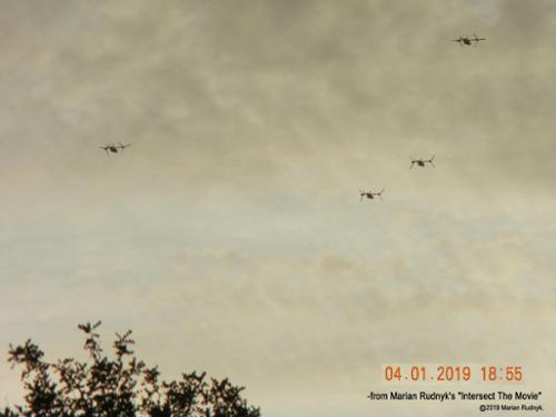 On April 1, 2019, four unmarked V-22 Ospreys flew over my house and into the nearby canyon mountains as they chased an unknown circular craft.  was able to shoot pictures and spectacular videos of what are supposed to be rarely publicly seen aircraft. [(c)2019MarianRudnyk. All Rights Reserved.]