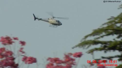This unmarked military helicopter was one of many helos that furiously circled a large white orb (not visible in this view) that was hovering over our foothill neighborhood. I was able to successfully catch the orb on video. [(c)2019MarianRudnyk. All Rights Reserved.]