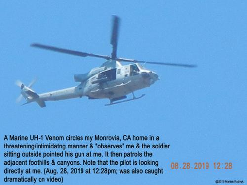 On Aug. 28, 2019, an unnumbered US Marine UH-1 Venom Helicopter circles directly over me so low that the soldiers & airmen on board angrily stare me down. This is one of many of such battlefield helicopters that appear here over my Monrovia, CA home. [(c)2019MarianRudnyk. All Rights Reserved.]