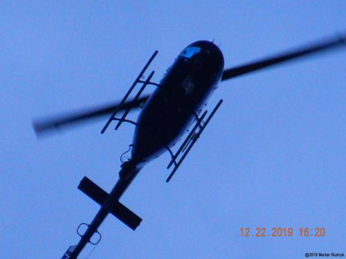 The helo makes a super low pass over me. Radar tracking websites blatantly falsified this helos location in an attempt to mislead the public. However, dozens of photos & nearly 15 minutes of video all confirmed its highly illegal actions (that violate strict FAA regulations). [(c)2019MarianRudnyk.]