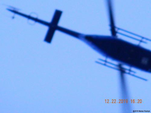 This Pasadena PD helicopter further breaks the law as it doubles down & makes an even lower pass at me. This is actually just one of many-many such helo-harassments I have endured. Make sure to check out the dramatic video of this event posted among my videos here. [(c)2019MarianRudnyk.]
