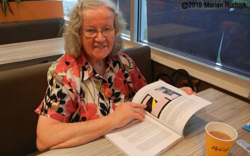 My 80 year old mom recently reading the nice over-sized paperback edition of my book, INTERSECT, while she & I were sharing a meal at the Monrovia McDiner (site of the Jan. 1, 2017 McDiner UFO Event). [(c)2019MarianRudnyk. All Rights Reserved.]